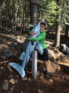 Catwater hugging the dolphin at the Pacific Crest Trail 1/2-Way monument at mile 1325